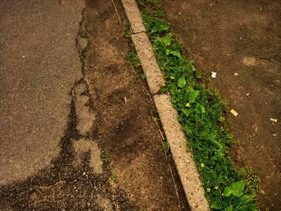 Street, grass and sand